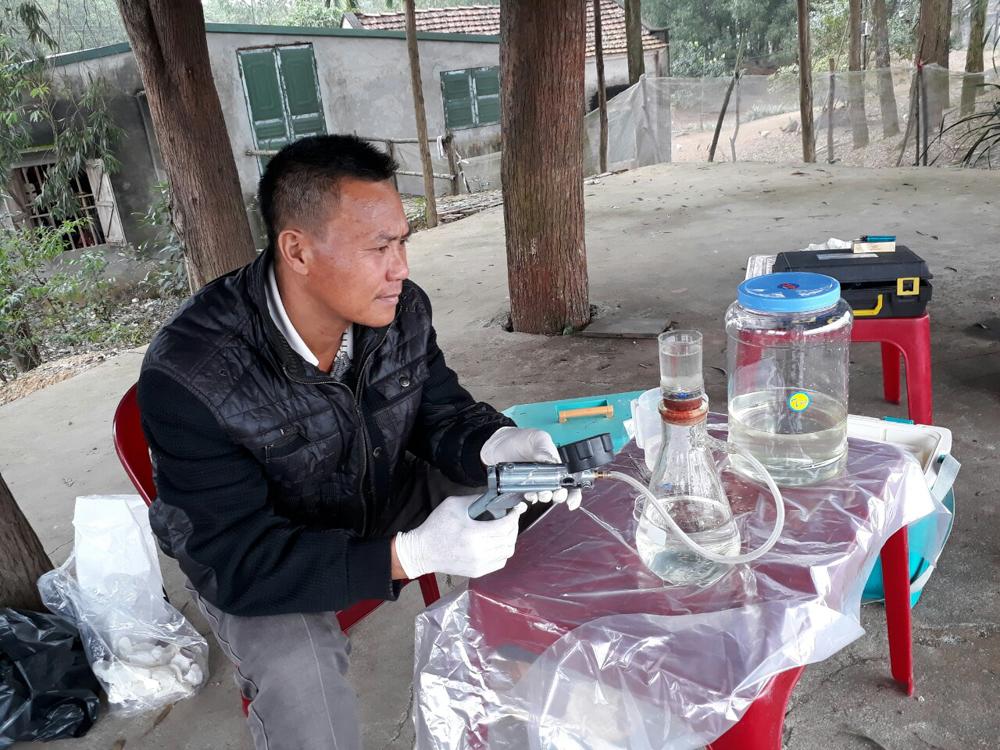 Man sampling water
