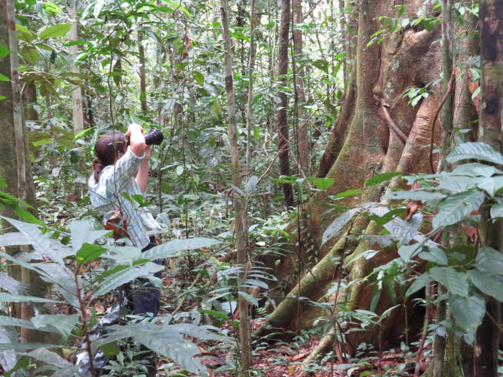 Reporter Christina Selby snapping shots in the Amazon jungles. (Photo by Laura K. Marsh)