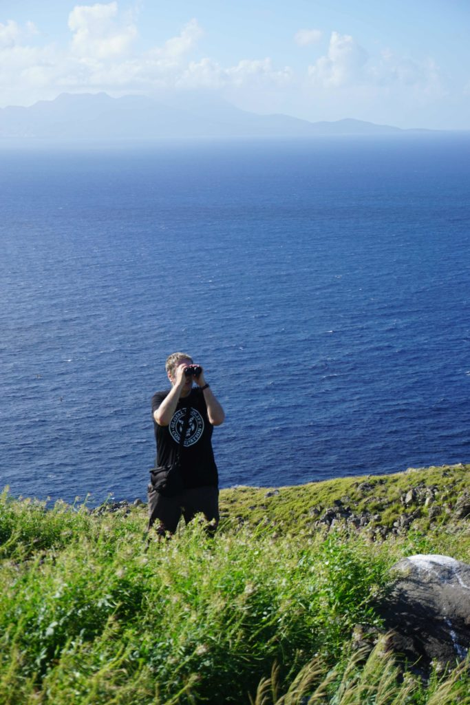 Me on Redonda Island, with Montserrat in the background. (Photo by Sophia Steele/FFI)