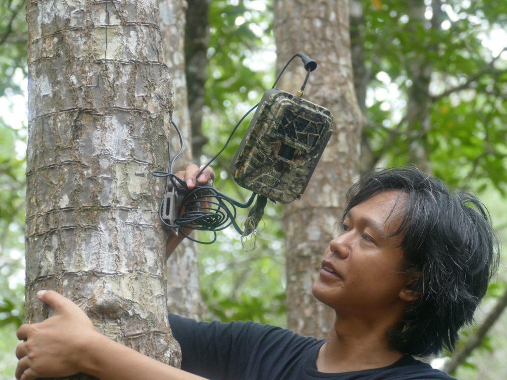 Checking an anti-poaching surveillance camera. (Photo by Mike Appleton)