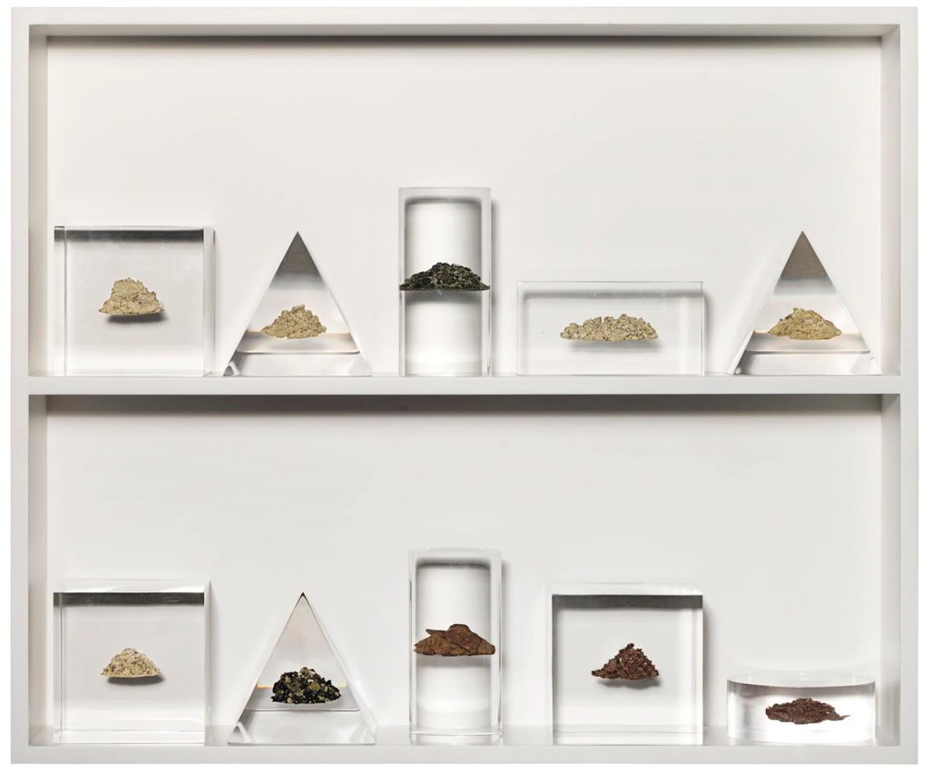 Ben Thorp Brown, Academic Forms with Rocks, Lucite, rock strata sampled at intervals of 10′ ranging from 10′ to 100′ of depth in the West Texas desert, on wood shelf overall: 20 x 24 in., 2016. Donated by the artist.