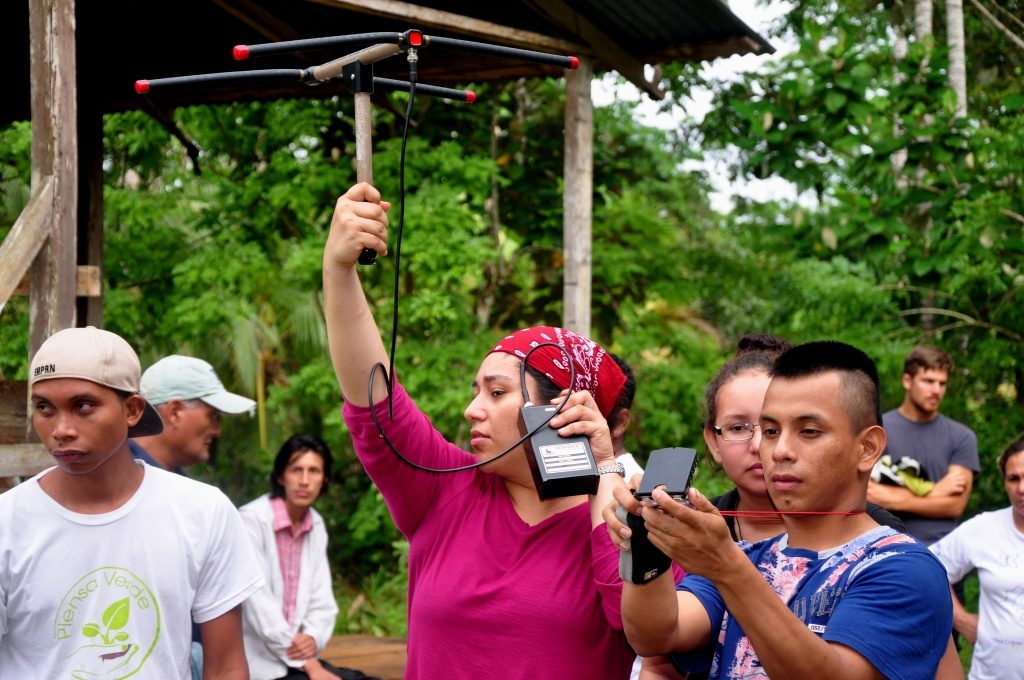 A student participates in a brief demonstration of telemetry equipment and triangulation. (Photo by Chris Jordan)