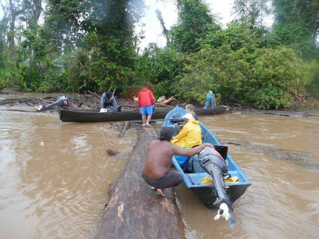 Hauling our boats across a fallen tree.