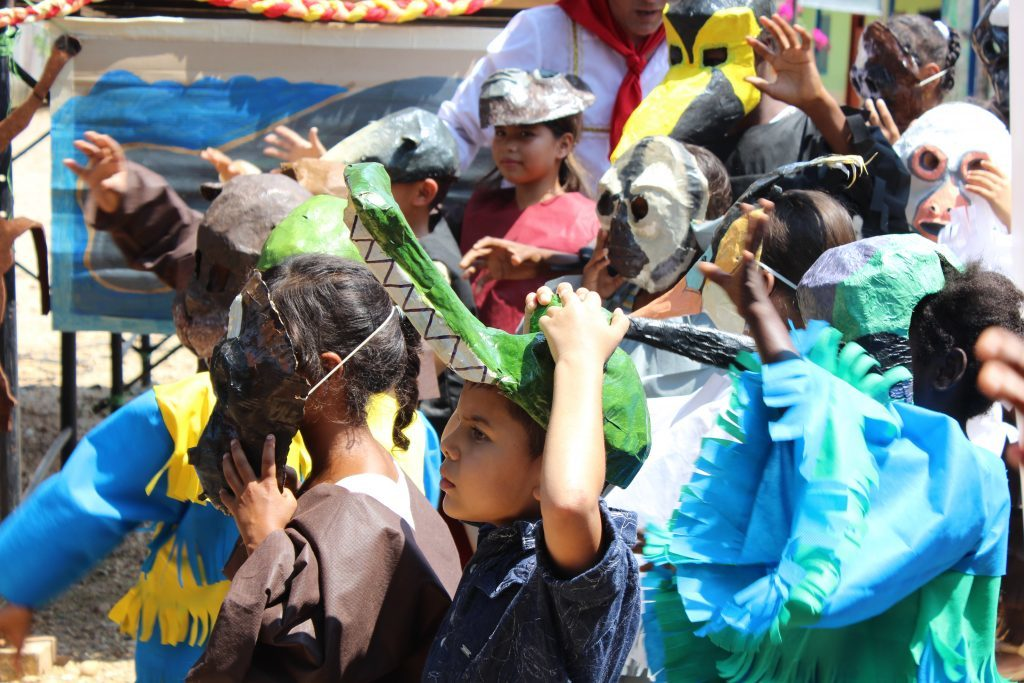 Local children celebrating the 4th brown spider monkey festival in Colombia. Photo courtesy Andres Link.