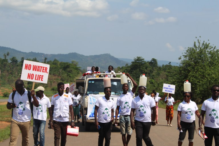 Protesters walk 59 miles with water to Ghana's statehouse in protest against the government's decision to allow bauxite mining in Atewa. (Photo courtesy of A Rocha)