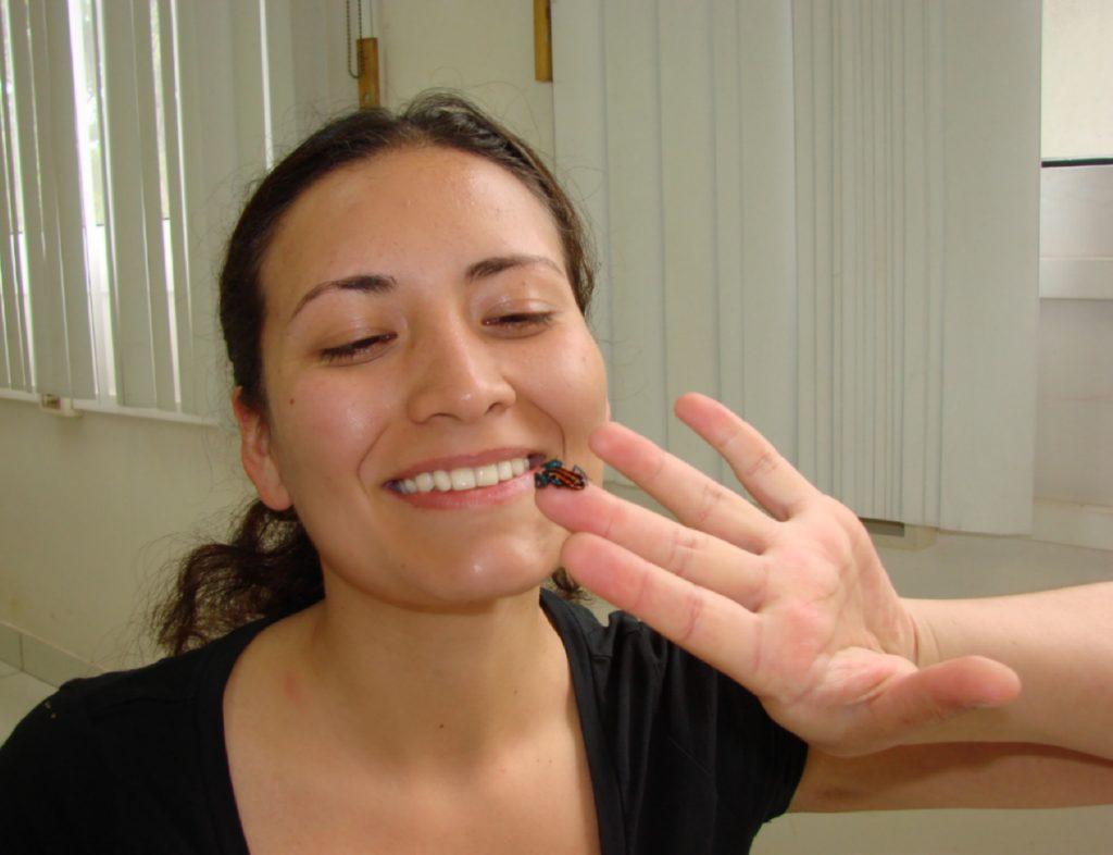 Teresa with a poison dart frog. (Photo courtesy of Teresa Camacho Badani)
