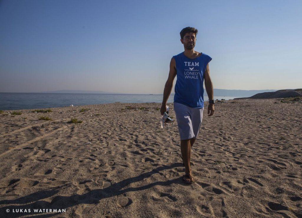 Adrian Grenier walks the beach. (Photo by Lukas Waterman)