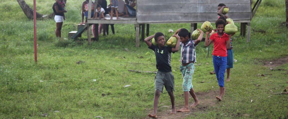 Children walking with coconuts in Indio Maiz