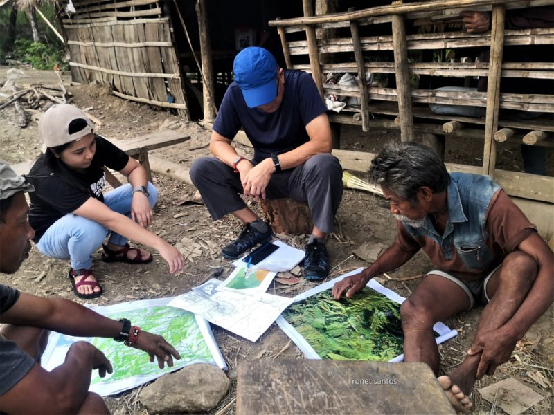 Tau-buid Tribal Chief Fausto Novelozo points in the map the location of the Tau-buid sacred sites within their ancestral domain