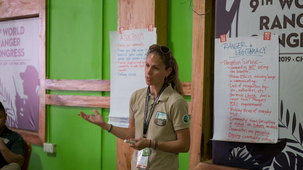 Cara Martel presenting to a group at the World Ranger Congress in Chitwan.