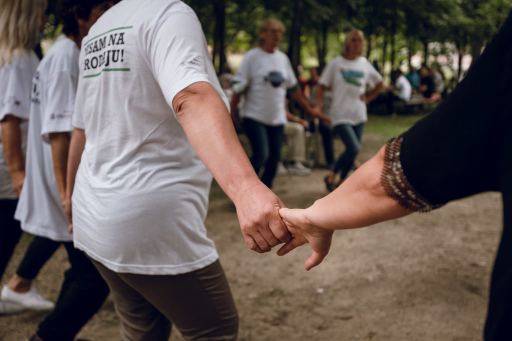 Brave Women of Kruscica hold hands.